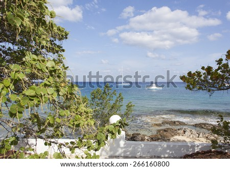 Framed view of drifting boats in the morning (Cozumel, Mexico). - stock photo