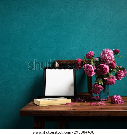 Frames and flower vase on color wall - 3D rendering - stock photo