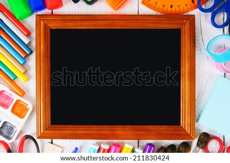 Framework and school tools around. On a white, wooden background. - stock photo