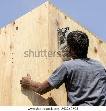 Framing construction contractor installing a beam pocket on a wood frame wall of a new luxury custom home - stock photo