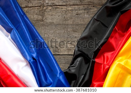 France and Germany Flag on a wooden Background, concept Partnership and friendship