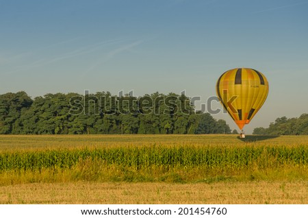 FRANCE BRISSAC-QUINCE 30 AUG: view of hot air baloons flying over fields near BRISSAC-QUINCE town on 30 august 2013
