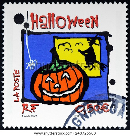 FRANCE - CIRCA 2001: a postage stamp printed in France showing pumpkin and a witch celebrating halloween, circa 2001. - stock photo
