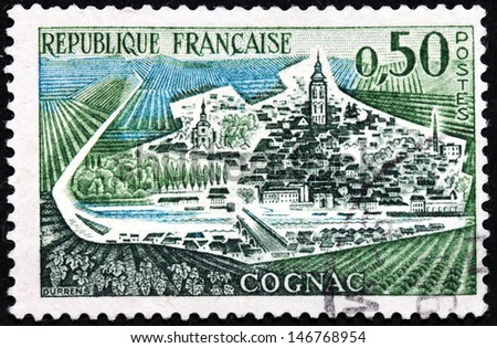 FRANCE - CIRCA 1961: a stamp printed by FRANCE shows bird's-eye view of Cognac town in the Charente department in southwestern France, circa 1961. - stock photo