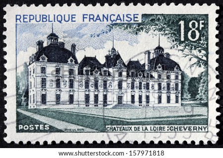 FRANCE - CIRCA 1954: A stamp printed by France shows Cheverny Chateau located at the departement of Loir-et-Cher in the Loire Valley, circa 1954. - stock photo