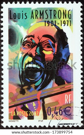 FRANCE - CIRCA 2002: A stamp printed by FRANCE shows image portrait of famous American jazz trumpeter and singer Louis Armstrong, circa 2002 - stock photo