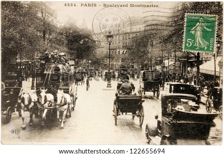 FRANCE - CIRCA 1913: a stamp printed by FRANCE shows Marianne the allegory of French Republic. The stamp is on the postcard shows view of Boulevard Montmartre in Paris, circa 1913.