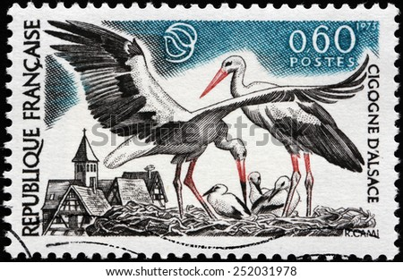 FRANCE - CIRCA 1973: A stamp printed by FRANCE shows Storks of Alsace. Alsace is located on France's eastern border and on the west bank of the upper Rhine adjacent to Germany, circa 1973 - stock photo