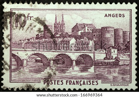 FRANCE - CIRCA 1941: A stamp printed by FRANCE shows view of  Angers town - The Maine river, the Castle, and the spires of the Cathedral, circa 1941. - stock photo