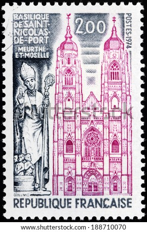 FRANCE - CIRCA 1974: A stamp printed by FRANCE shows view of Basilique Saint-Nicolas - basilica in the town of Saint-Nicolas-de-Port, Meurthe-et-Moselle, Lorraine region of France, circa 1974 - stock photo