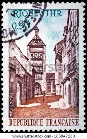 FRANCE - CIRCA 1971: A stamp printed by FRANCE shows view of Dolder Tower in Riquewihr. Riquewihr is a commune in the Haut-Rhin department in Alsace in north-eastern France, circa 1971 - stock photo