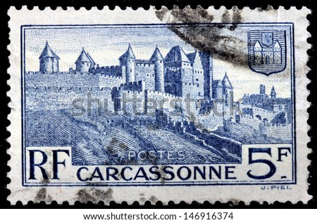 FRANCE - CIRCA 1932: a stamp printed by FRANCE shows view of fortified Medieval Carcassonne town in the Aude department, in the former province of Languedoc, France, circa 1932.