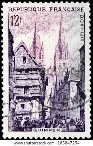 FRANCE - CIRCA 1954: A stamp printed by FRANCE shows view of Quimper - capital of the Finistere department of Brittany in northwestern France, circa 1954 - stock photo