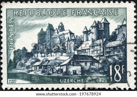 FRANCE - CIRCA 1956: A stamp printed by FRANCE shows view of Uzerche town in the Correze department - The Vezere river, the Castle, and the Abbey Church, circa 1956. - stock photo