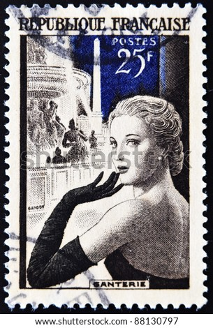 FRANCE - CIRCA 1939: A stamp printed in France a beautiful lady with a glove in reference to gallantry, circa 1939
