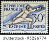 FRANCE - CIRCA 1953: A stamp printed in France devoted to fencing, circa 1953 - stock photo