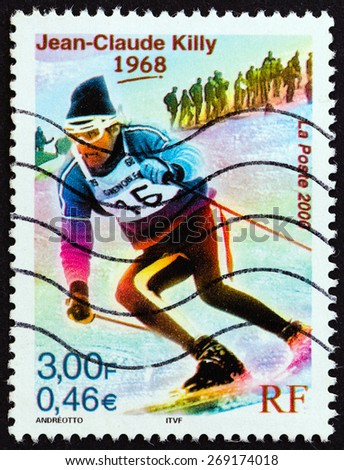 """FRANCE - CIRCA 2000: A stamp printed in France from the """"Sport Events of the 20th Century """" issue shows Jean-Claude Killy (Olympic Gold medalist downhill, giant and special slalom, 1968), circa 2000. - stock photo"""