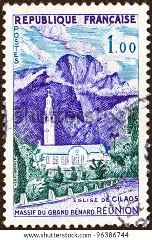 "FRANCE - CIRCA 1960: A stamp printed in France from the ""Tourist Publicity"" issue shows Cilaos Church and Great Bernard Mountains, Reunion, circa 1960."