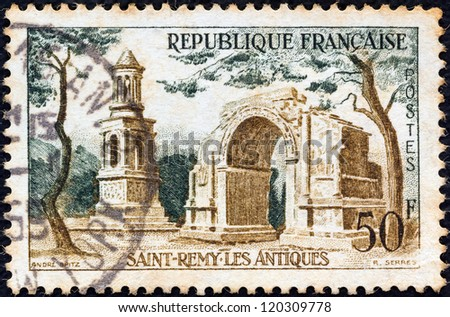 "FRANCE - CIRCA 1957: A stamp printed in France from the ""Tourist Publicity"" issue shows  Les Antiques, Saint Remy, circa 1957."