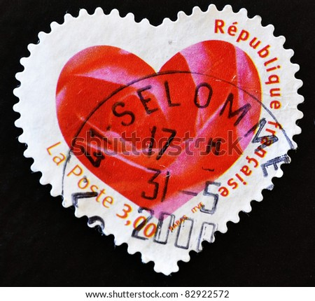 FRANCE - CIRCA 2003: A stamp printed in France showing a seal with the petals of a pink heart-shaped, circa 2003