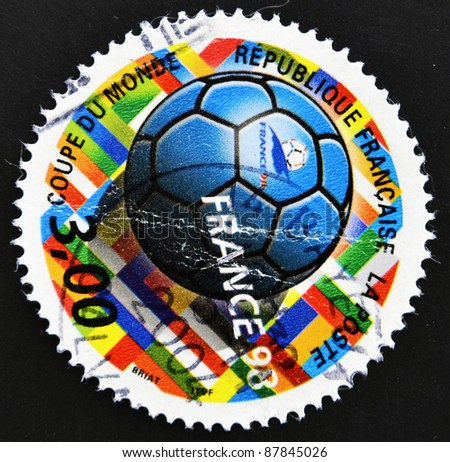 FRANCE - CIRCA 1998: A stamp printed in France shows ball-shaped relation to the football world cup, circa 1998 - stock photo