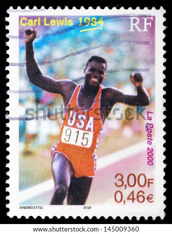 FRANCE - CIRCA 2000: A stamp printed in France shows Carl Lewis, 1984, circa 2000 - stock photo