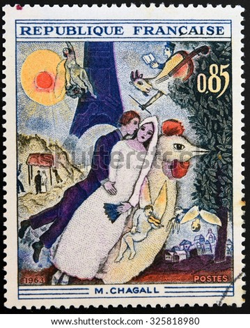 FRANCE - CIRCA 1963: A stamp printed in France shows engraving after painting Married couple at the Eiffel Tower by Marc Chagall, circa 1963 - stock photo