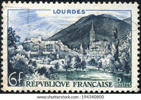 FRANCE - CIRCA 1958: A stamp printed in France shows Lourdes, circa 1958 - stock photo