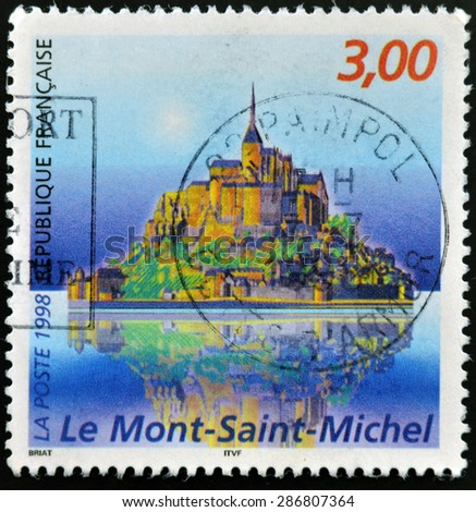 FRANCE - CIRCA 1998: A stamp printed in France shows Mont Saint Michele, circa 1998  - stock photo