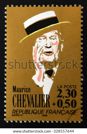 FRANCE - CIRCA 1990: A stamp printed in France shows portrait Maurice Chevalier, circa 1990. - stock photo