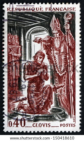 FRANCE - CIRCA 1966: a stamp printed in the France shows Bishop Remi Baptizing King Clovis, King of the Franks, 496 A.D., circa 1966 - stock photo