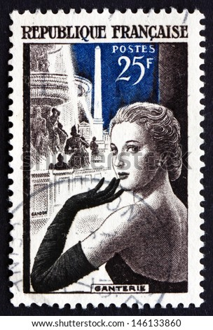 FRANCE - CIRCA 1955: a stamp printed in the France shows Glove Model in Place de la Concorde, Paris, French Glove Manufacturing, circa 1955 - stock photo