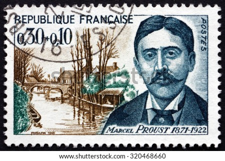FRANCE - CIRCA 1966: a stamp printed in the France shows Marcel Proust, French Novelist, Critic and Essayist, and St. Hilaire Bridge, Illiers, circa 1966 - stock photo