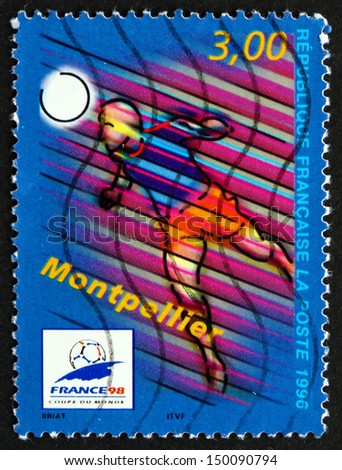 FRANCE - CIRCA 1996: a stamp printed in the France shows Montpellier, Host City of 1996 World Cup Soccer Championships, Stylized Action Scene, circa 1996 - stock photo