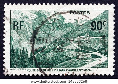 FRANCE - CIRCA 1937: a stamp printed in the France shows Mountain Road at Iseran, Savoy, circa 1937