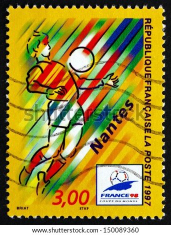 FRANCE - CIRCA 1997: a stamp printed in the France shows Nantes, Host City of 1998 World Cup Soccer Championships, Stylized Action Scene, circa 1997 - stock photo
