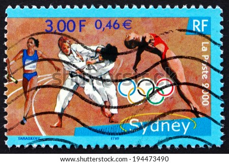 FRANCE - CIRCA 2000: a stamp printed in the France shows Relay Racer, Judo, Diving, 2000 Summer Olympics, Sydney, circa 2000 - stock photo