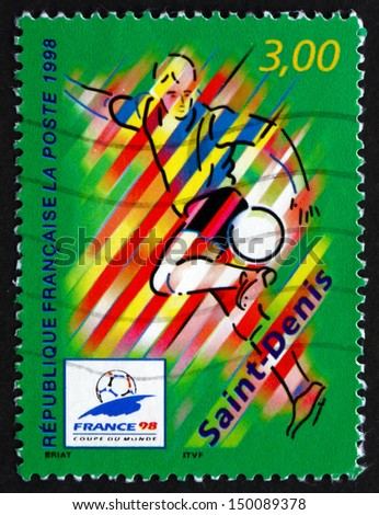 FRANCE - CIRCA 1998: a stamp printed in the France shows Saint-Denis, Host City of 1996 World Cup Soccer Championships, Stylized Action Scene, circa 1998 - stock photo