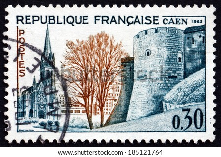 FRANCE - CIRCA 1963: a stamp printed in the France shows St. Peter's Church and Ramparts, Caen, circa 1963 - stock photo