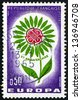 FRANCE - CIRCA 1954: a stamp printed in the France shows Symbolic Daisy, Flower with 22 Petals Symbolize 22 Members of Conference, CEPT, circa 1954 - stock photo