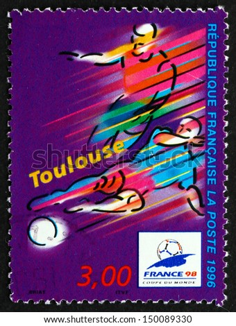 FRANCE - CIRCA 1996: a stamp printed in the France shows Toulouse, Host City of 1996 World Cup Soccer Championships, Stylized Action Scene, circa 1996 - stock photo