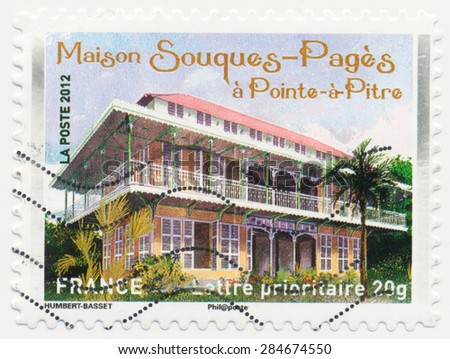FRANCE - CIRCA 2012: a stamp printed in the France shows  Villa Souques-Pages in  Pointe-a-Pitre, circa 2012 - stock photo