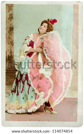 FRANCE - CIRCA 1902: a vintage postcard printed in FRANCE shows hand painted photograph of beautiful French dancer. Circa 1902. - stock photo