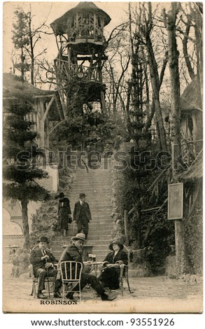 FRANCE - CIRCA 1919: Antique postcard printed in France shows Restraunt The large tree - Le grand arbre - du Plessis, Robinson, France, 1919