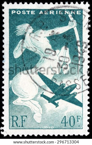 FRANCE - CIRCA JULY, 1946: A stamp printed by FRANCE shows a symbolic representation of Sagittarius. Sagittarius, half human and half-horse, is the centaur of mythology. - stock photo