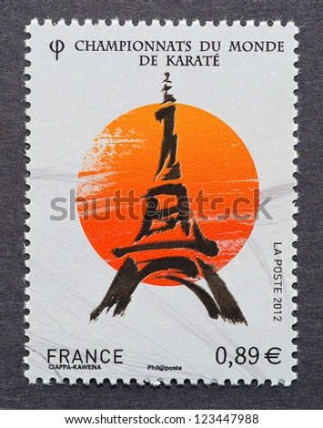 FRANCE -Â?Â? CIRCA 2012: postage stamp printed in France showing an image of the Eiffel Tower commemorative of the Karate World Championship held in Paris, circa 2012. - stock photo