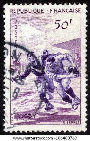 FRANCE - CIRCA 1956: stamp printed by France, shows players in Rugby, circa 1956