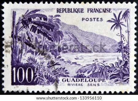 FRANCE - CIRCA 1957: stamp printed in France shows Guadeloupe, Sens river, circa 1957 - stock photo