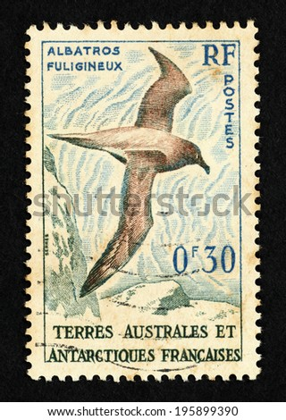FRANCE - CIRCA 1959: Stamp printed in France with image of a Sooty Albatross flying over the French Southern and Antarctic Territories. - stock photo