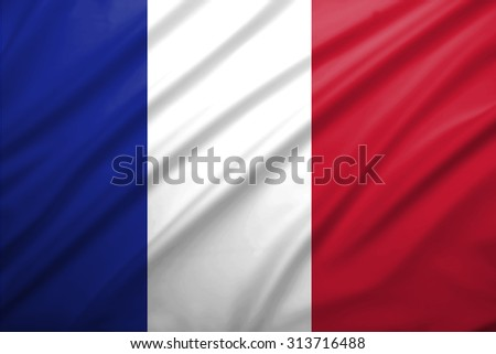 France flag blowing in the wind. Background texture. - stock photo